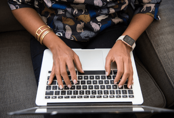 nonprofit communications agency: a Black femme from above on a MacBook laptop